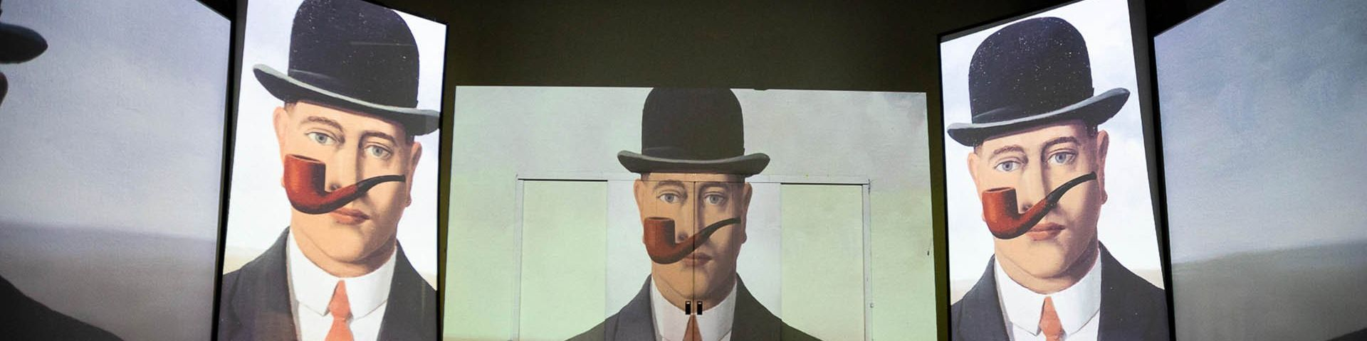 Magritte's La Bonne Foi or 'Good Faith' projected three times side by side on the walls of the exhibition.